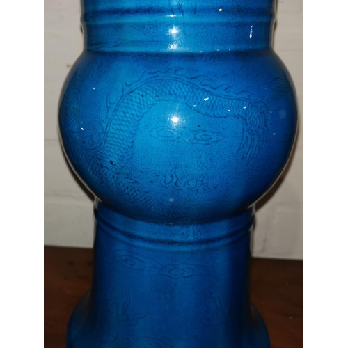 141 - A Chinese Kangxi beaker vase decorated in low relief with dragons and fish under bright turquoise gl...