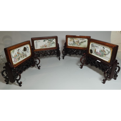 263 - A Chinese porcelain set of 4 table screens, each decorated with genre scenes, carved frames with scr...