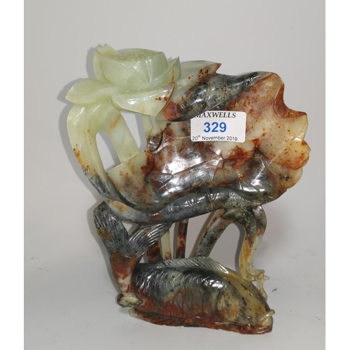 329 - A Chinese jade carving of carp under lily fronds, 19 cm...