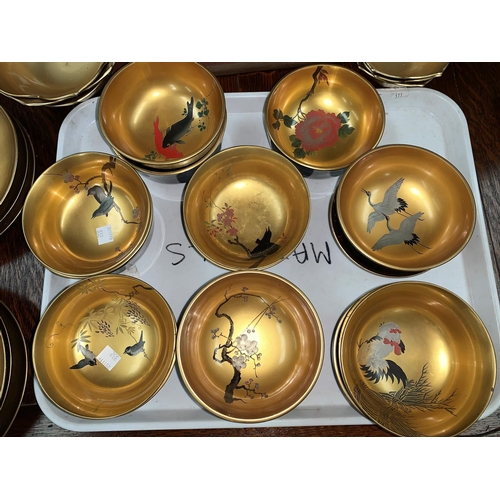 332 - An oriental set of 12 gilt lacquer bowls with enamelled naturalistic decoration; 4 further bowls; 6 ...