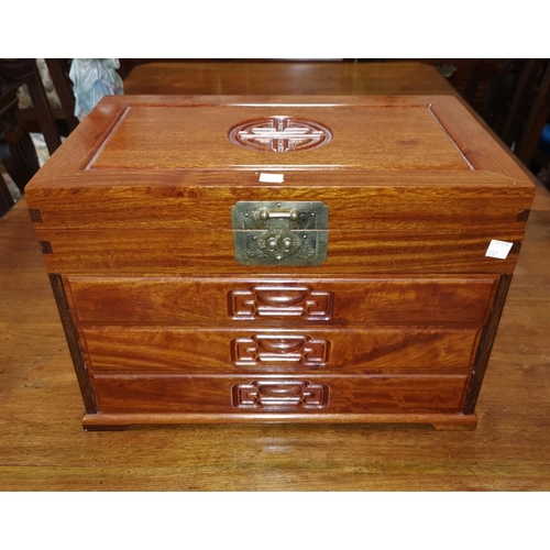 357 - An oriental hardwood miniature cabinet of 4 drawers fitted for cutlery...