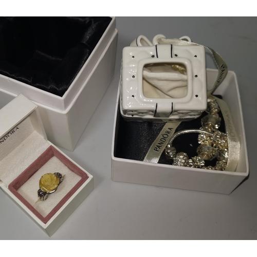 370 - A Pandora china gift box, boxed; a Pandora style ring...