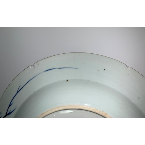 140a - A Chinese blue & white plate decorated with a pagoda with rabbits in the garden, diameter 23 cm (min...