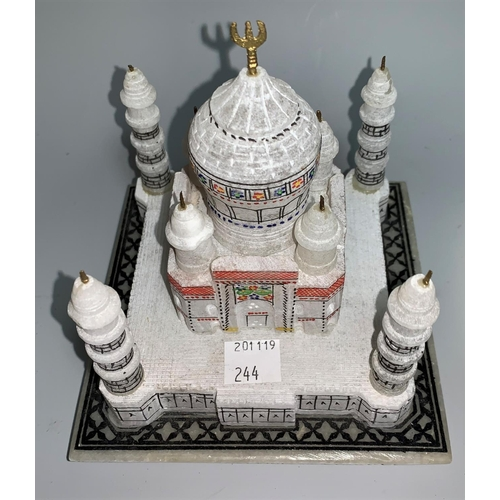 244 - An Indian alabaster circular plaque inlaid semi-precious stones, 23 cm; a similar item...