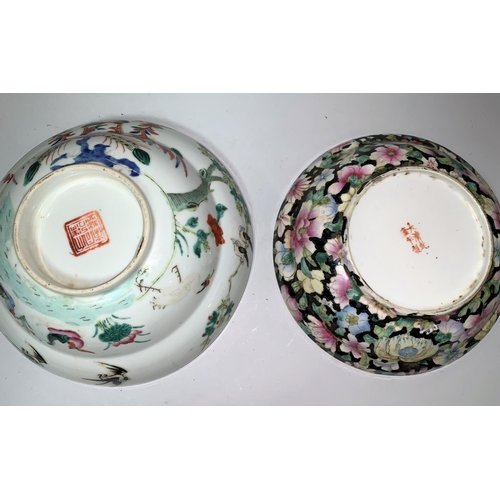 264 - A Chinese porcelain decorated with flowers on black ground, red 6 character mark, 19.5 cm; another b...