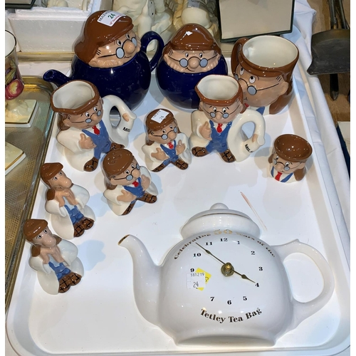 24 - A collection of Wade Tetley Tea items including teapot, cruet pieces, wall clock etc & 3 Homepride f...