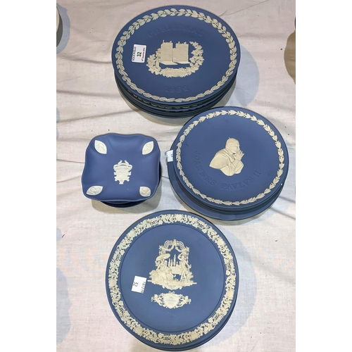32 - A collection of Wedgwood blue Jasperware plates, including 6 Christmas plates; 10 smaller plates and...