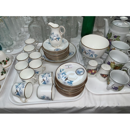 5 - An early 20th century part tea service decorated with sailing boats and oriental imagery in cream, b...