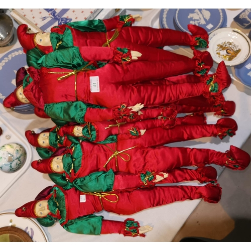 41 - Seven large and 3 small jester dolls in red and green costume...