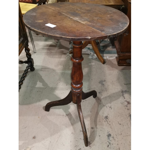 379 - An early 19th century circular mahogany wine table on tripod base...