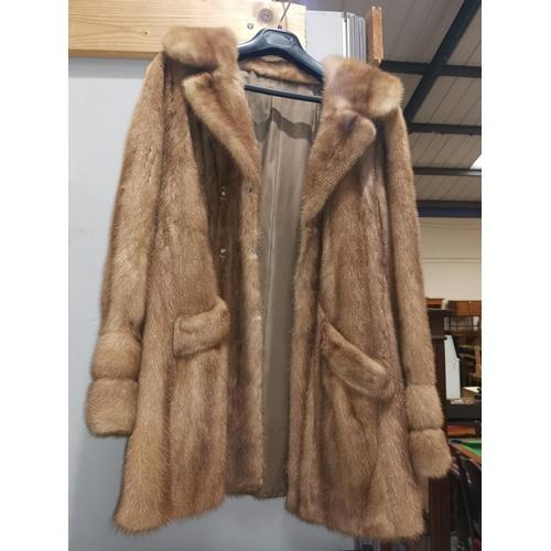 152a - A honey mink jacket...