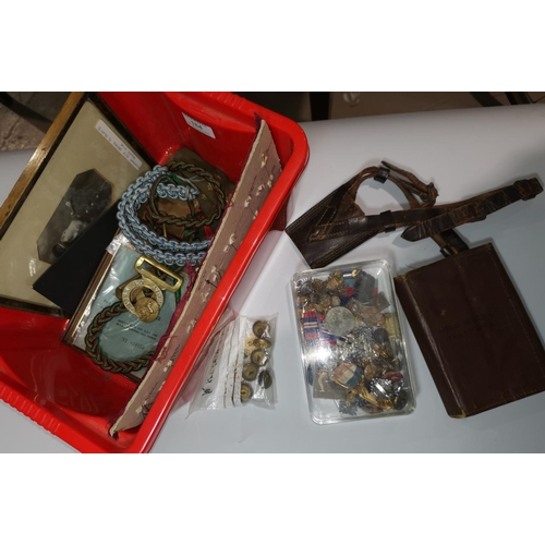 184 - A quantity of militaria including a 1914 field service book; lanyards; etc....