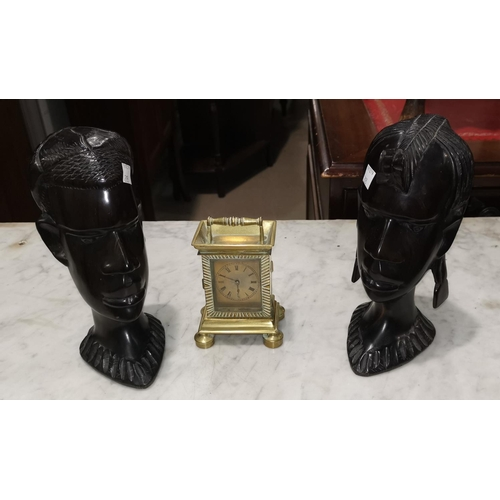 203 - A pair of African carved hardwood busts, 21 cm; a quantity of table linen; a carriage clock  with 19...