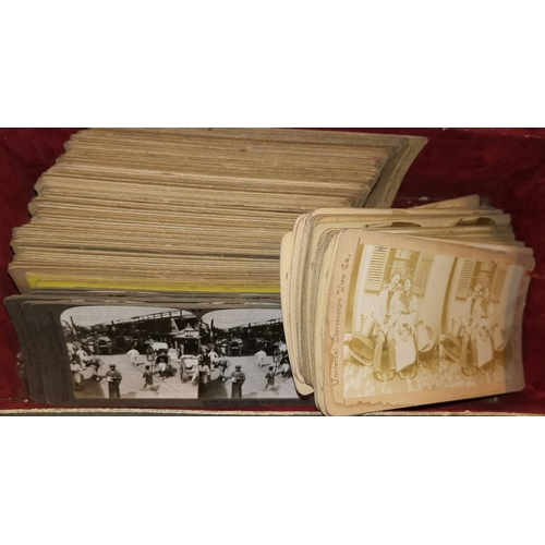 215 - A collection of stereo slides and a handheld viewer; a further group of 48 WWI stereo cards...