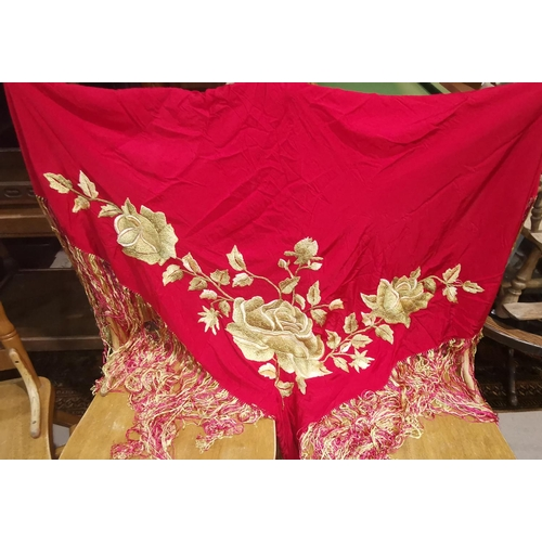 253 - An embroidered red crepe shawl, 122 cm square  NO BIDS SOLD WITH NEXT LOT...
