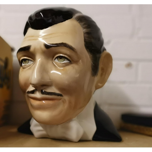 266 - A ceramic head portrait of Clark Gable; 2 reproduction film posters; 2 books...