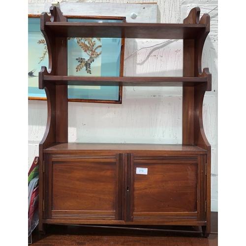 378 - An Edwardian mahogany wall shelf unit with cupboard under...
