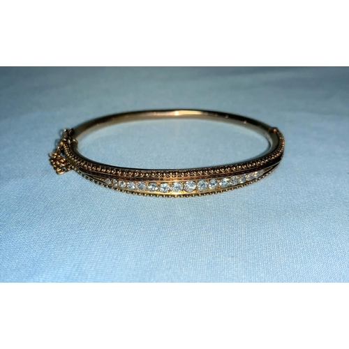 276 - A 19th century hinged bangle set 17 old cut graduating diamonds, 12,8 g approx. gross weight, 1.82 c...
