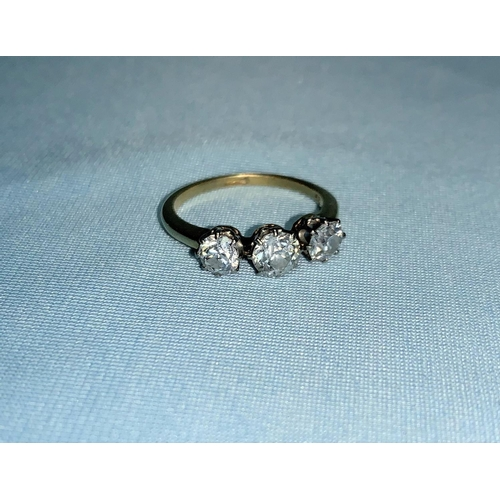 277 - A yellow metal ring set 3 diamonds, central stone .65 ct approx., gross diamond weight 1.5 ct approx...