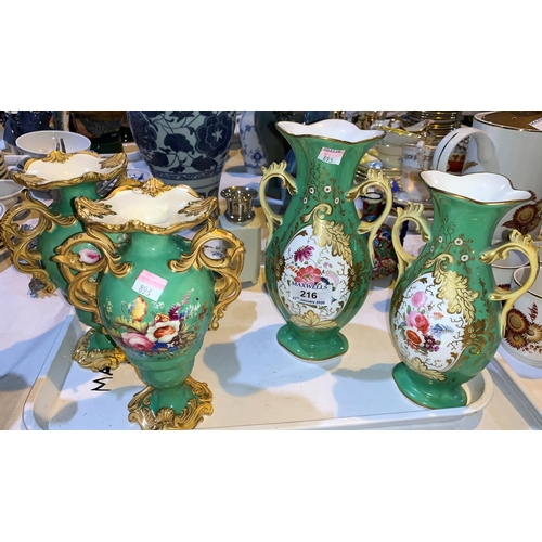 216 - A 19th century pair of 2 handled baluster vases in the rococo style, with polychrome floral decorati...