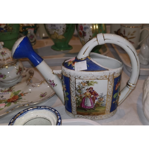 219 - A Dresden china watering can with polychrome decoration; a similar inkstand and vase; a similar plat...
