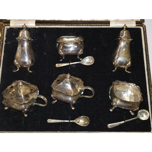 361 - A silver Georgian style 6 piece cruet set with matching spoons, cased...