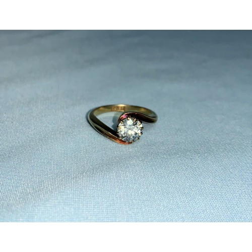 278 - An 18 carat gold ring with solitaire diamond in crossover setting, diamond weight 1.17 ct approx., s...