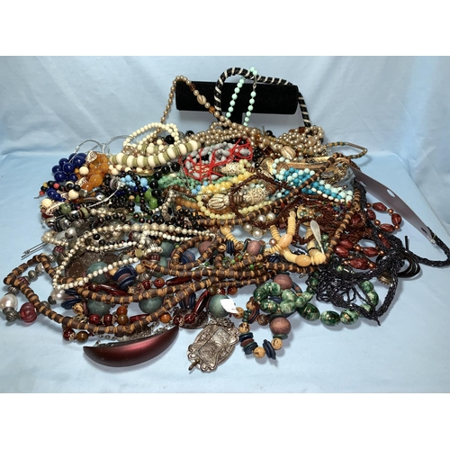 391 - A large selection of costume bead and other necklaces...