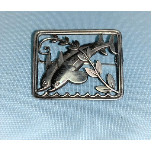 424 - Georg Jensen:  sterling silver rectangular brooch, 2 dolphins leaping through waves and frond, lengt...