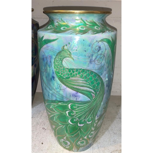 262 - Walter Slater for Shelley, a large tapering lustre vase decorated with peacocks in green and gilt ag...