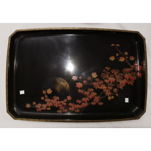 100a - An oriental large lacquerwork rectangular tray decorated with a settin sun and leaves, paper label o...