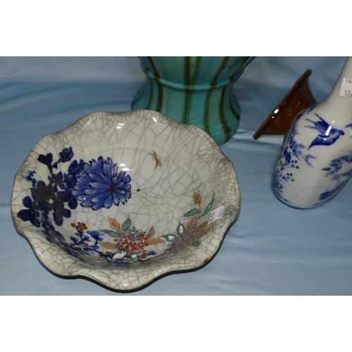 102a - A Japanese Kutani porcelain bottle vase, 18 cm; a bowl with craquelure glaze, 22 cm; a large orienta...