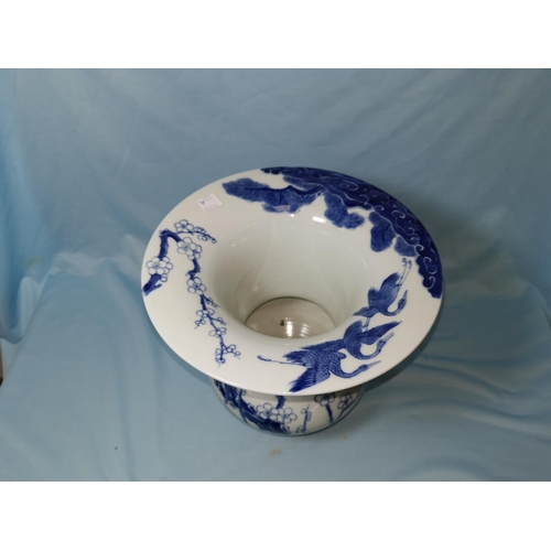 108A - A Chinese blue and white inverted baluster vase / spittoon with flared rim, decorated with birds on ...