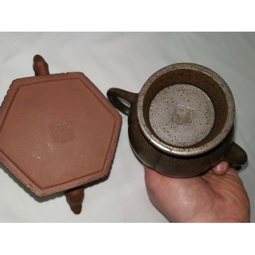108B - Two Yixing terracotta teapots, both signatures to base...