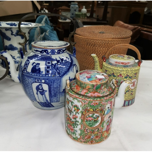 108c - Three Chinese teapots, 1 with wicker basket carrier