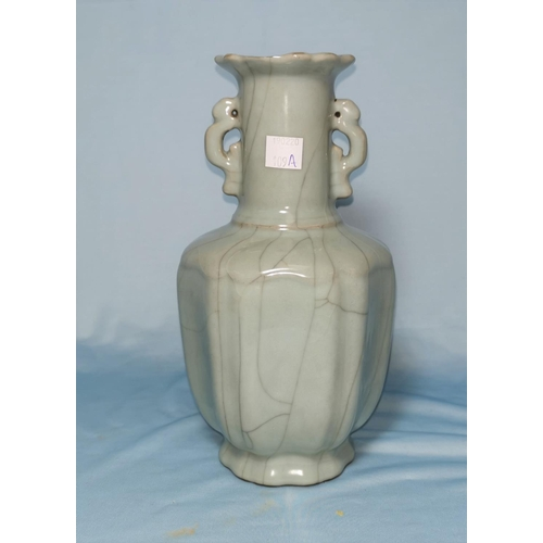 109A - A Chinese celadon crackle glaze ribbed vase, signature to base, 23cm (chip to rim)