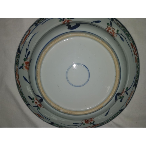 110B - A Chinese Kangxi period famille verte plate with central floral decoration, 29cm...