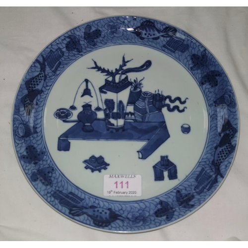 111 - A 19th century Chinese blue and white plate with detailed border and central decoration of vases, 23...