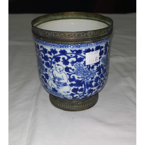 111B - A Chinese Kangxi period vase decorated in blue and white with figures, copper rim and pedestal foot,...
