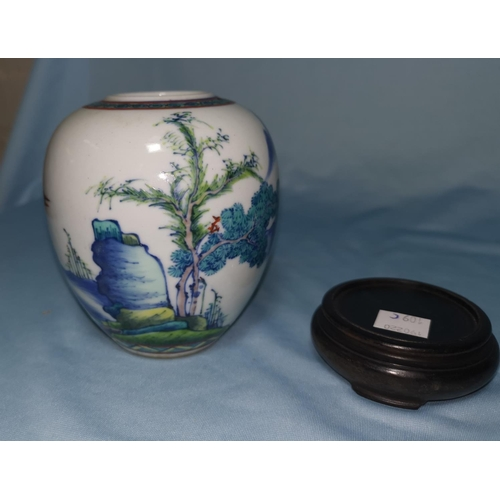 109C - A Chinese vase decorated with polychrome scenes, on wooden stand, height of vase 10cm...