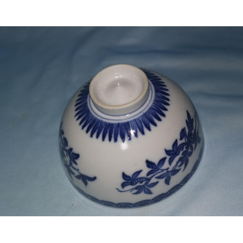 112A - A Chinese Qing dynasty Ming style rice bowl decorated in blue and white, with protruding point to ba...