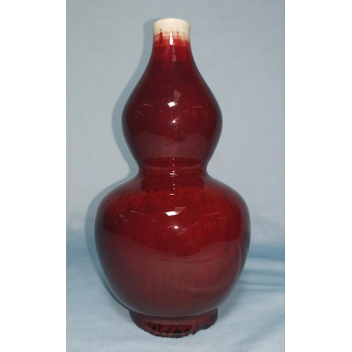114B - A Chinese flambe double gourd shape vase signed and double circle to base, height 20cm...