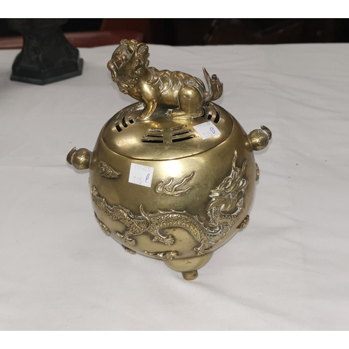 115B - A Chinese ovoid brass censer with dragon decoration and seated Dog of Fo to lid, character mark to b...
