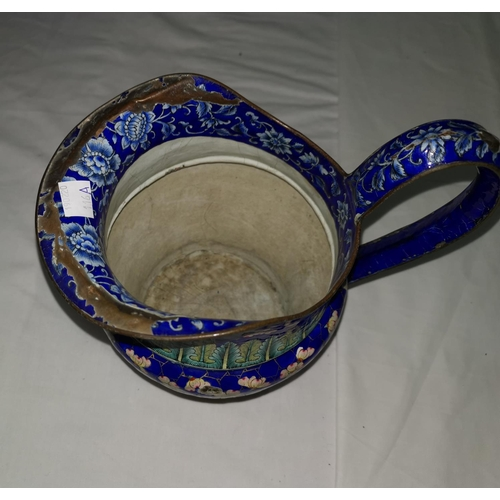 116A - A large Chinese blue enamel on copper jug with prunus and bamboo decoration, height 21cm (some patch...