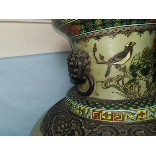 121 - A large late 19th century Chinese baluster  vase with dark brown glazed bronze effect rim and mounts...