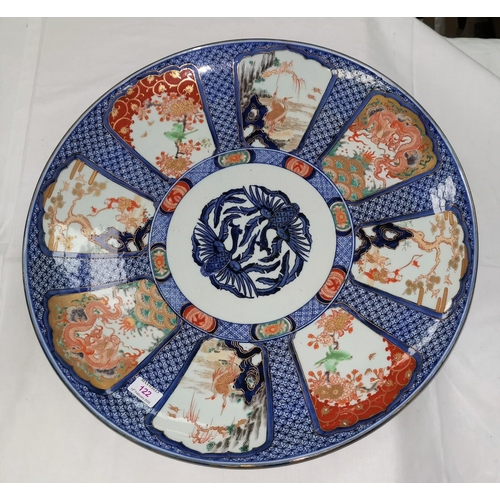 122 - An impressive 19th century Japanese Imari porcelain saucer dish of large size decorated in underglaz...