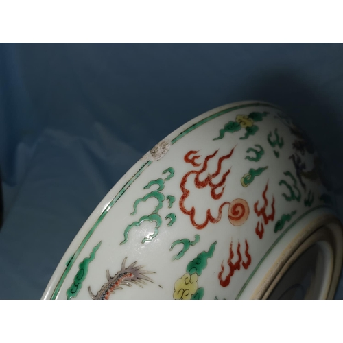 123 - A famille verte charger in the style of the Chinese Kang Shi period, decorated with large dragon to ...
