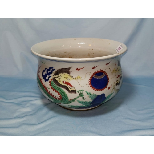 126 - A Chinese Qing circular censer bowl of baluster form, with polychrome decoration of dragons, 25 cm d...