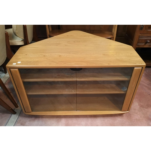 652 - A modern Ercol lightwood corner television unit with double glazed doors under, 71 cm deep...