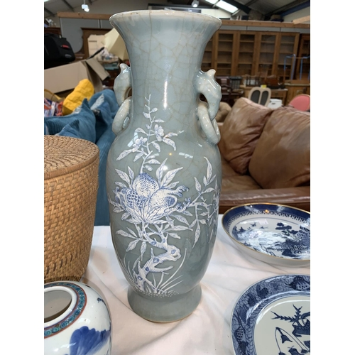109B - A Chinese celadon crackle glaze vase with raised blue and white floral decoration, hand painted sign...